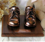 Bronze baby shoes - Bronzed baby shoes make a great memento or bronzed keepsake for both the parent & child. We do baby shoe bronzing and we can mount the shoes in frames. They look great on bookends.